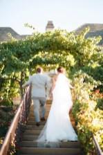 artistic temecula wedding photographer churon winery couple walking on stairs