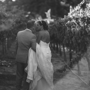 artistic temecula wedding photographer inn at churon winery couple in vineyard