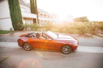 artistic temecula wedding photographer inn at churon winery just married bride and groom in mustang convertible