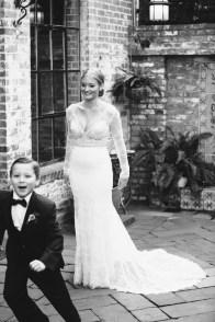 bride in courtyard carondelet house