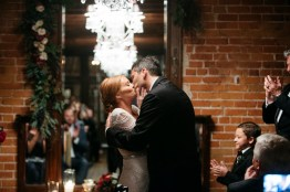 bride and groom kissing carondelet house wedding