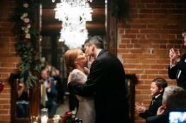 bride and groom kissing carondelet house wedding