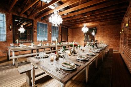 carondelet wedding reception room farm table place setting