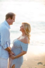orange county maternity photographer nicole caldwell crystal cove beach couple holding hands