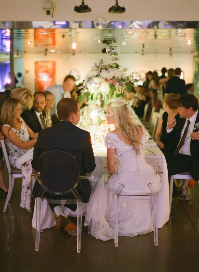 seven degrees wedding photographer nicole caldwell who uses film cinestill couple at head table