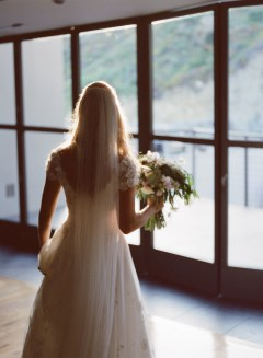seven degrees wedding photographer nicole caldwell who uses film cinestill back of bride
