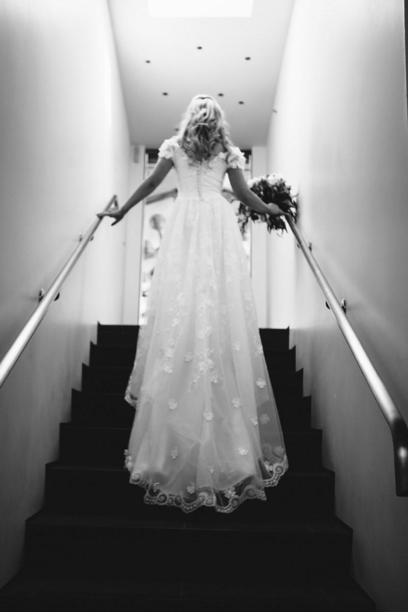 laguna beach wedding venue seven degrees photographer nicole caldwell bride on stairs