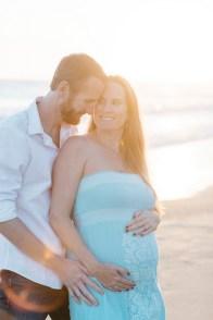 couple pose laguna beach maternity photographer nicole caldwell crystal cove