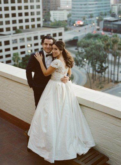 film rooftop jonathan club downtown la weddings bride and groom nicole caldwell