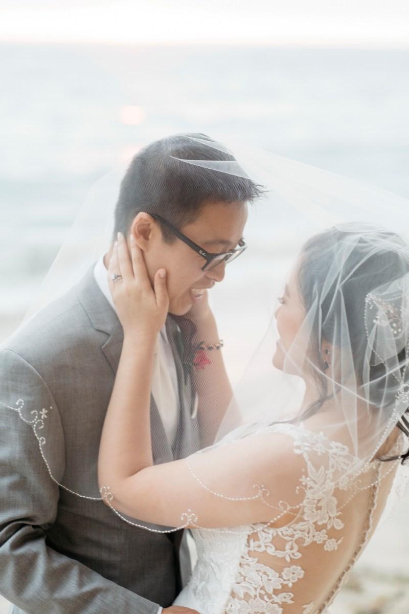 surf and sand resort wedding photographer nicole caldwell ride and groom beach photos