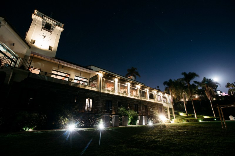exterior of bel air bay club wedding at night