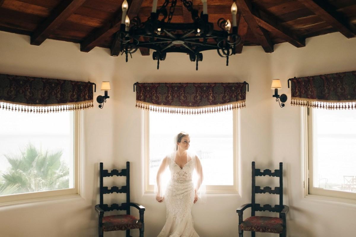 casa romantica san clemente wedding photographer artistic bride in window