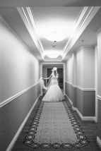 bride in hallway Monarch beach resort wedding photographer nicole caldwell