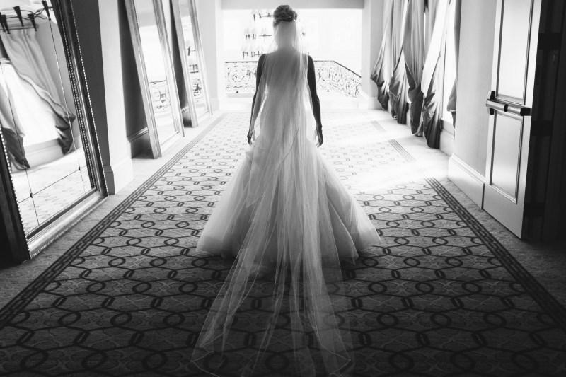 bride walking Monarch beach resort wedding photographer nicole caldwell