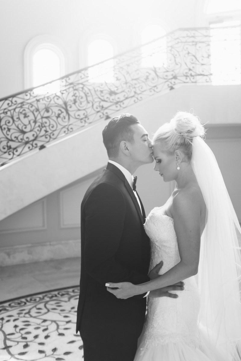 bride and groom stairs Monarch beach resort wedding photographer nicole caldwell