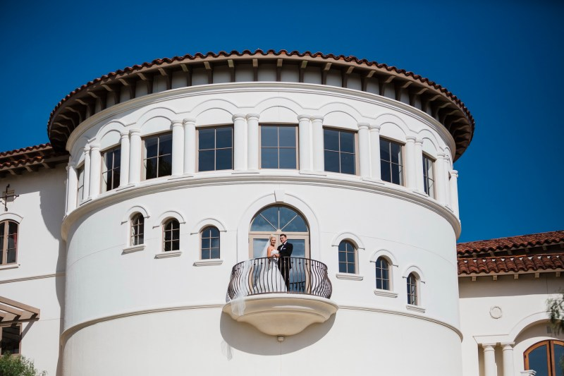 bride and groom on balcony Monarch beach resort wedding photographer nicole caldwell