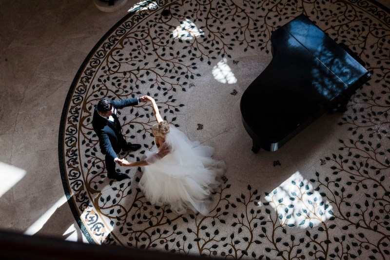 bride and groom dancing piano Monarch beach resort wedding photographer nicole caldwell
