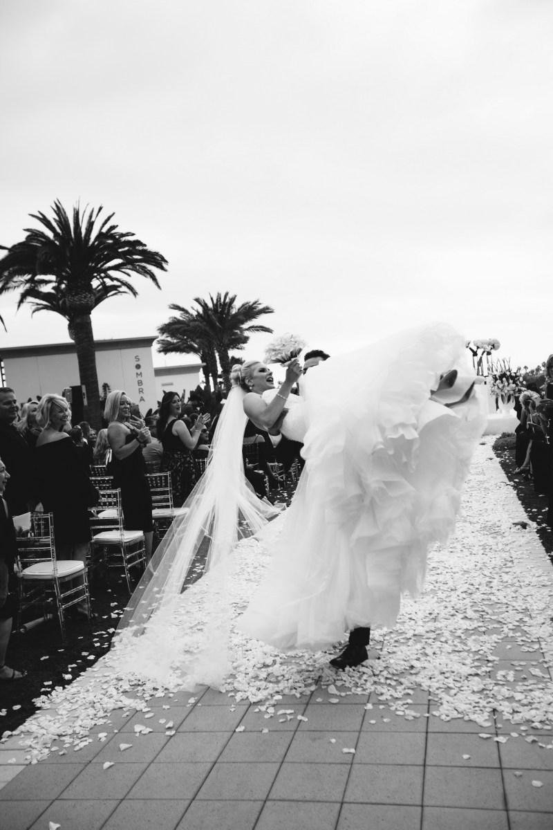 bride and groom walking down aisle Monarch beach resort wedding photographer nicole caldwell