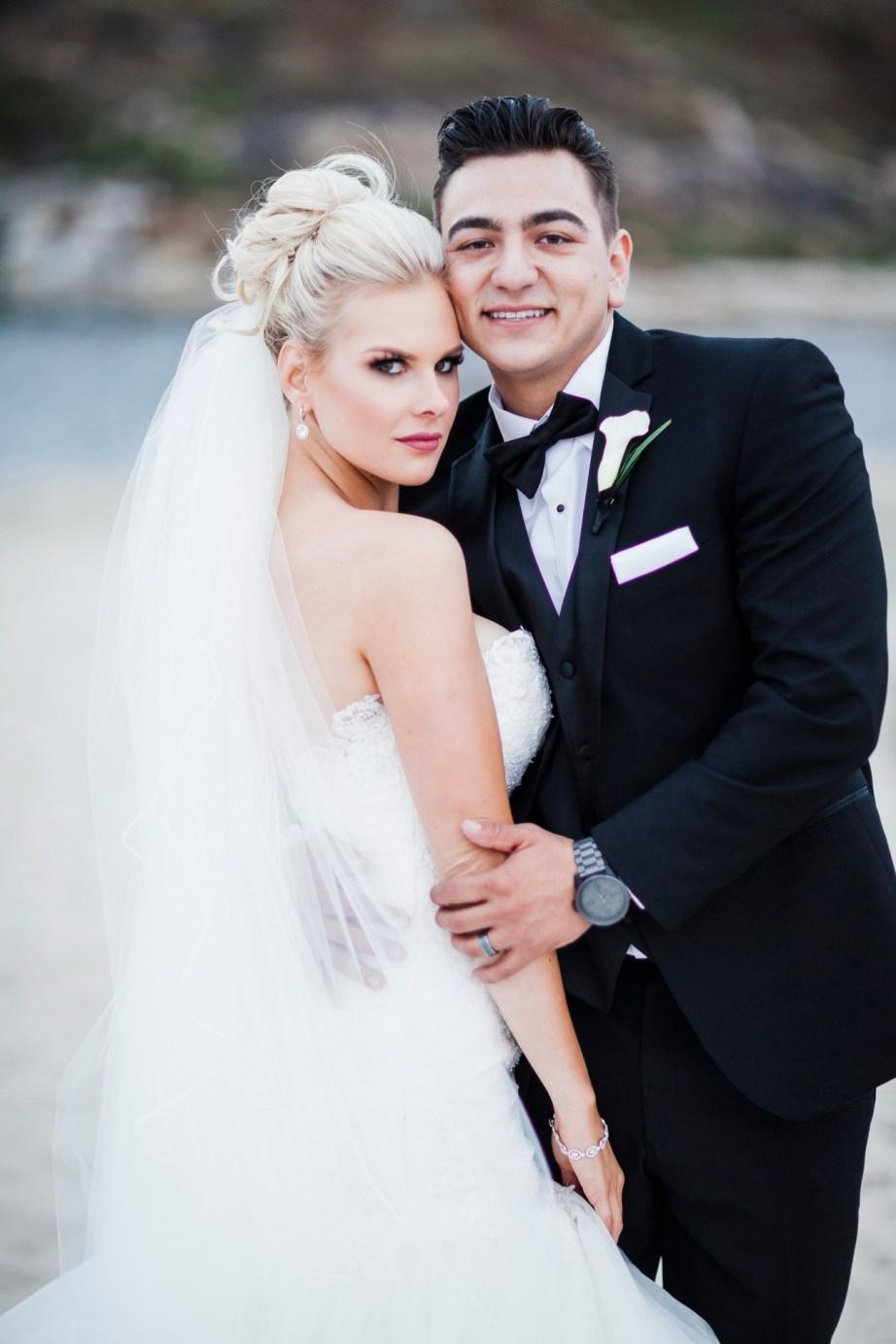 bride and groom on beach Monarch beach resort wedding photographer nicole caldwell