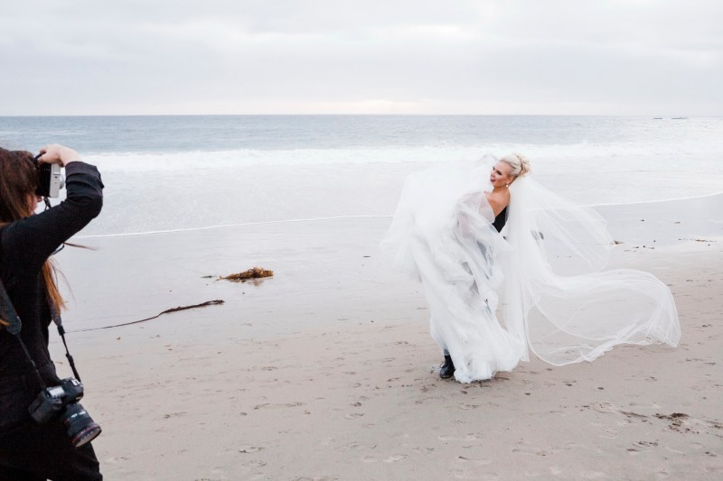 bride and groom and photographer on beach Monarch beach resort wedding photographer nicole caldwell