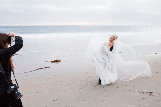 bride and groom and photographer on beach Monarch beach resort wedding photographer nicole caldwell