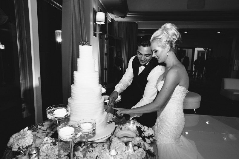 bride and groom wedding recption cqake cutting Monarch beach resort wedding photographer nicole caldwell