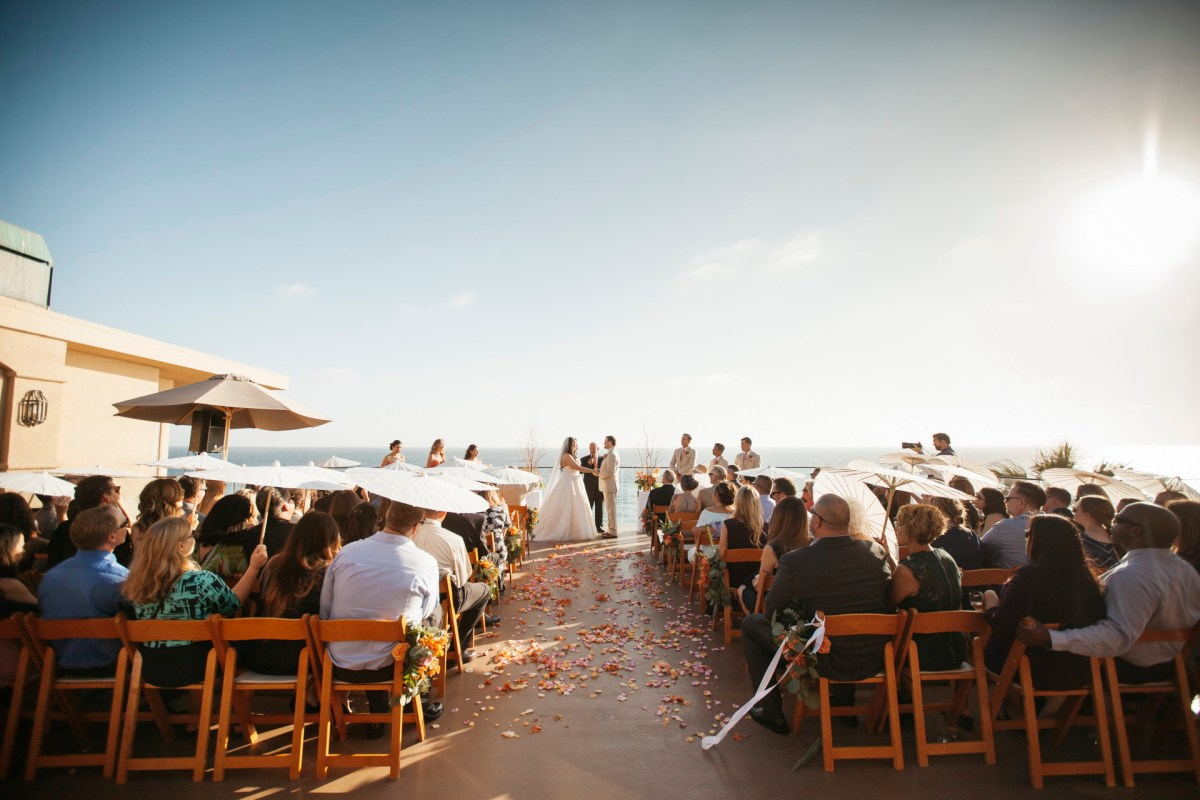 ceremony surf and sand resort wedding photographer nicole caldwell