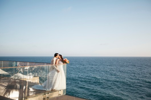 bride and groom on catalina deck surf and sand resort wedding photographer nicole caldwell