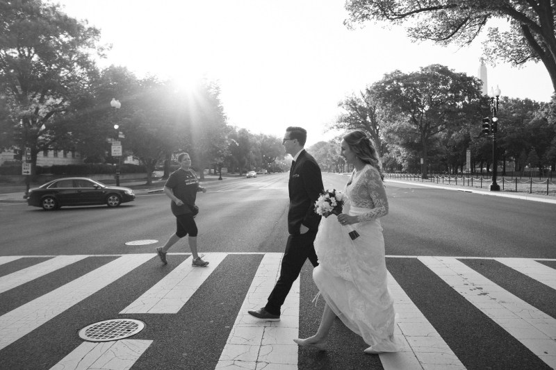 bride and groom crossing street washington dc wedding and elopement by nicole caldwell