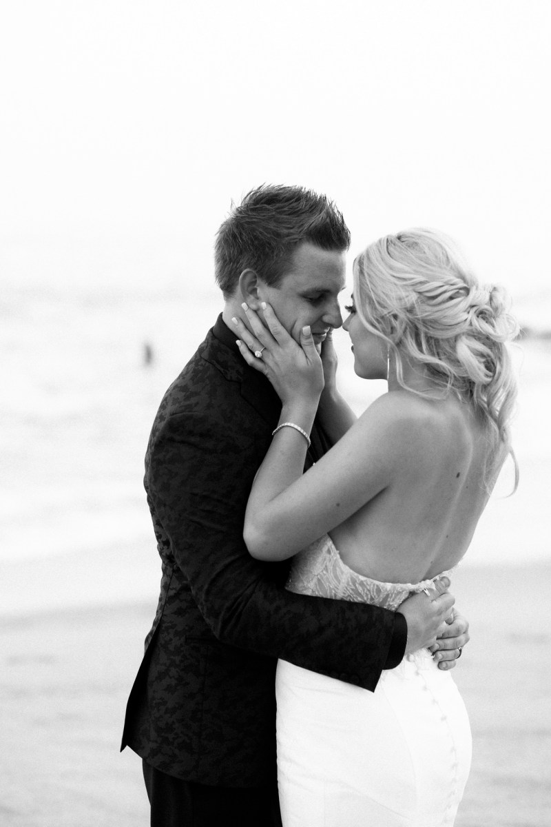 bride and groom kissing bride and groom wedding montage laguna beach