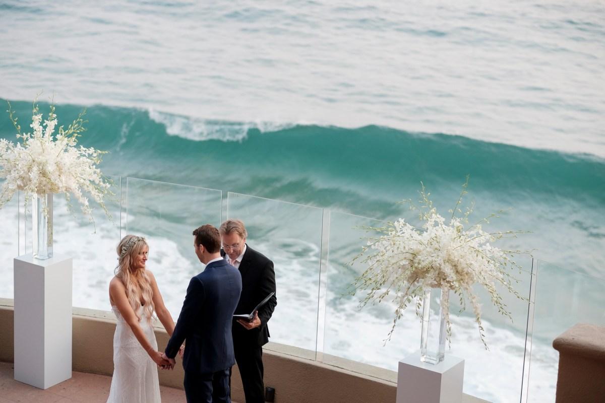bride and groom holding hands wedding ceremony ocean terrace wedding photos surf and sand resort laguna beach