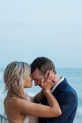 bride and groom loving embrace wedding photos surf and sand resort laguna beach