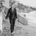 bride and groom walking wedding photos surf and sand resort laguna beach