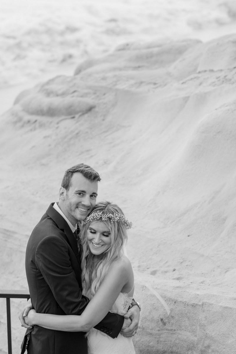 bride and groom embrace wedding photos surf and sand resort laguna beach