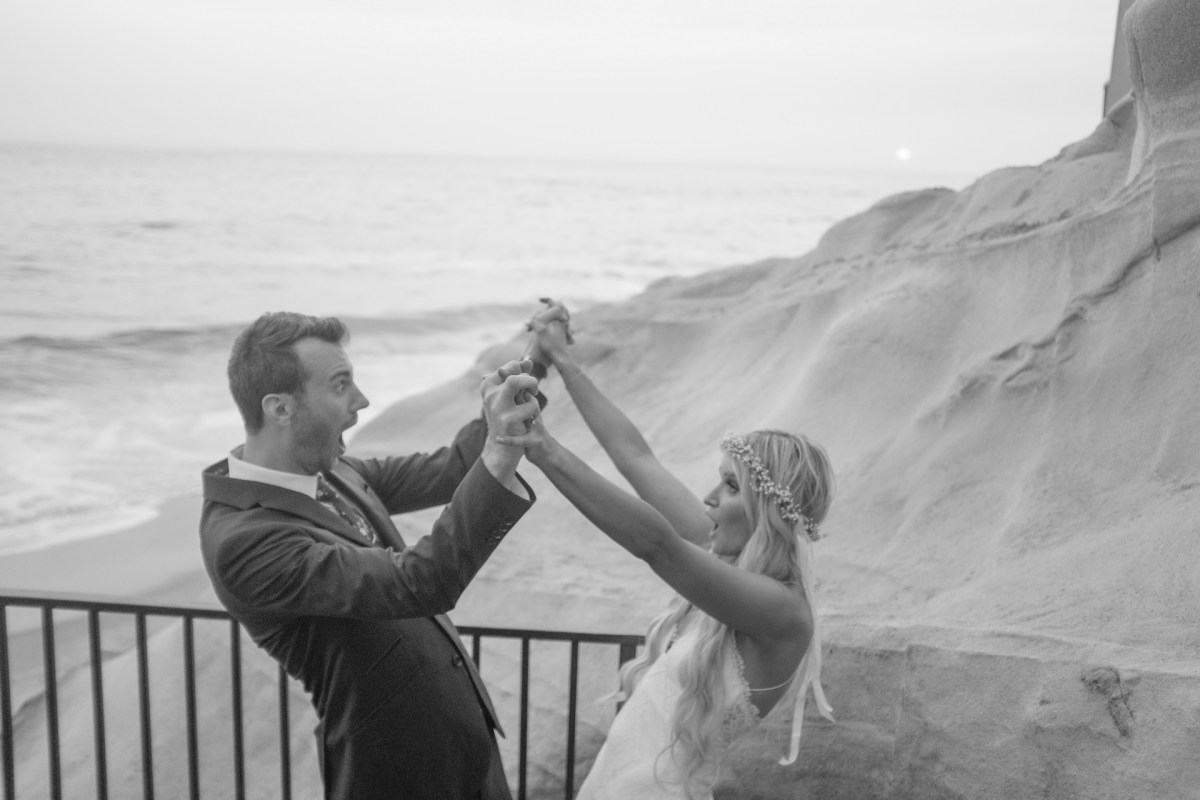 bride and groom hi five wedding photos surf and sand resort laguna beach