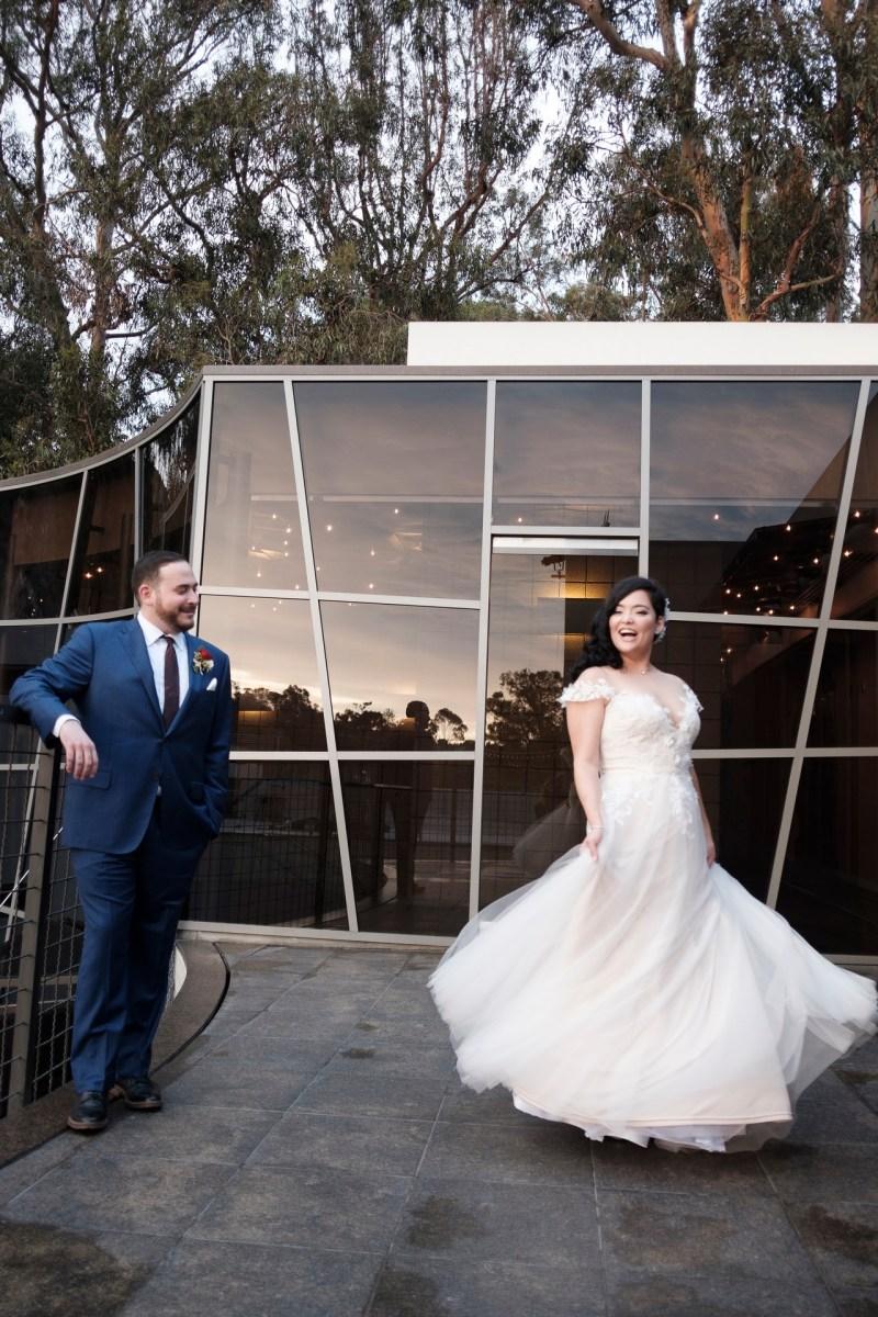 bride and groom twirling seven degrees wedding photographer laguna beach