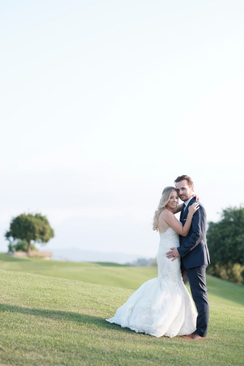 bride and groom on golf course Coto De Caza Raquet and golf club weddings by nicole caldwell