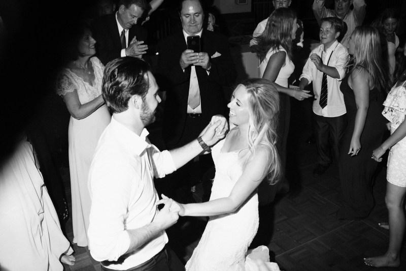bride and groom on dance floor Coto De Caza Raquet and golf club weddings by nicole caldwell