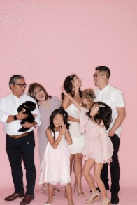 family photography orange county photographer nicole caldwell pink backdrop with dogs 11