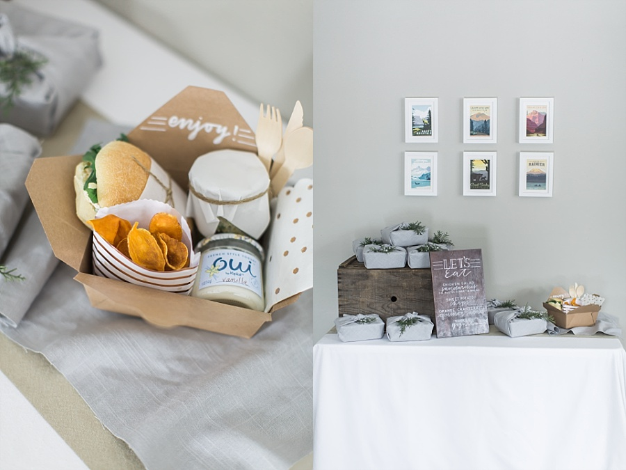 picnic boxed lunch displayed under national parks posters at baby shower