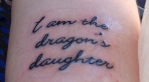 In a previous Spellbound Scribes post, I said I was going to get this tattoo to remind me I'm a strong woman and have a duty to create strong female characters, and I did! http://spellboundscribes.wordpress.com/2014/05/12/we-are-all-the-dragons-daughters-what-a-got-video-taught-me-about-strong-women/