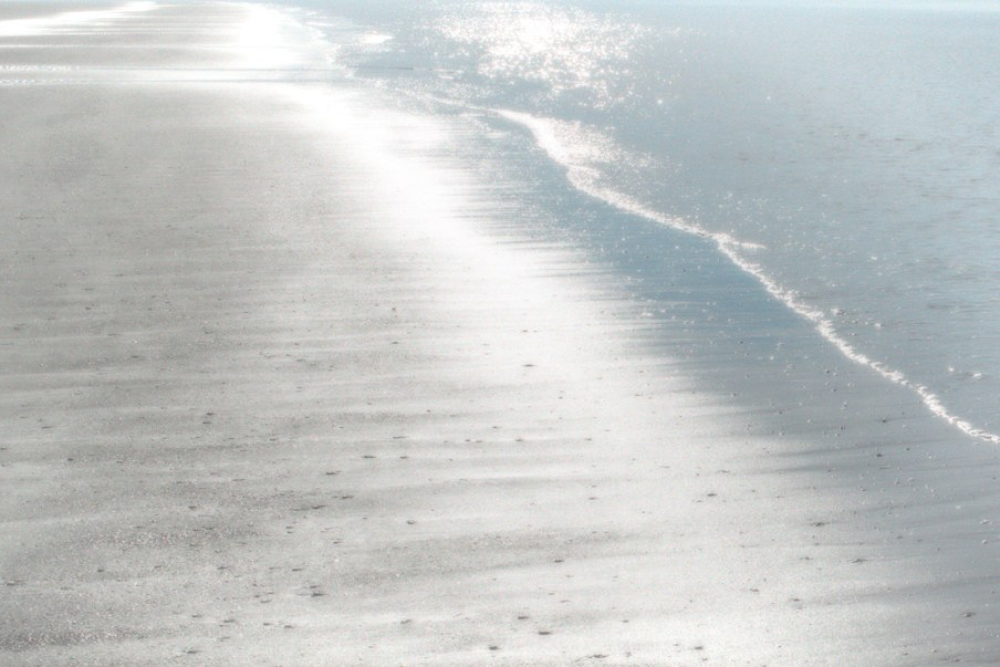 Art photo glittering rippling water on the beach