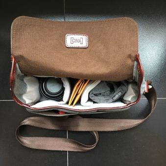 This is a typical way I would pack my ONA Bowery bag for a day of photos: one extra lens, small accessories (batteries, gloves, etc.) and maybe even another small lens (not shown). I also put my wallet nice and snug in the middle to keep sticky fingers away from it!