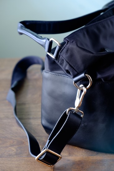 The longer strap is detachable, so you can remove it altogether or replace it with something that suits your preference.