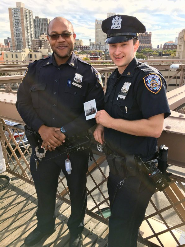 Photograph of two policemen on the Brooklyn Bridge with the Polaroid OneStep 2. © Nicole S. Young — nicolesy.com
