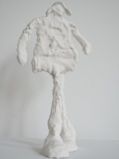 Learning to fly ( porcelain-like casting compound, height 25 cm)