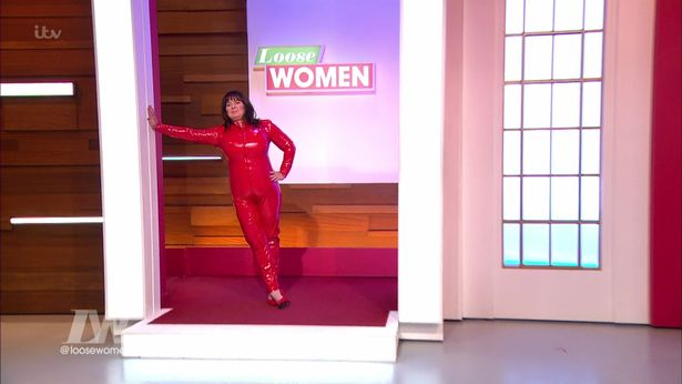 coleen-nolan-copies-britney-spears-by-wearing-a-red-latex-outfit