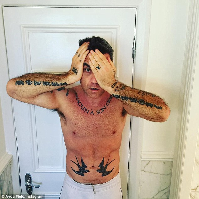robbie-williams-tattoo-addiction-is-rubbing-on-on-his-four-year-old-daughter