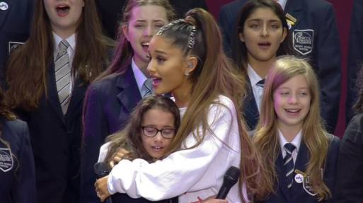 Ariana Grande Cuddles Young Singer Live On Stage At Manchester One Love Concert