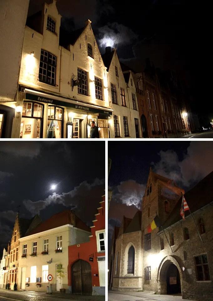 Angestrahlte Gebäude im Mondschein in Brügge auf der Flandern Rundfahrt